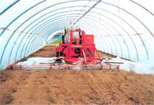 Tracked sterilizer inside a greenhouse