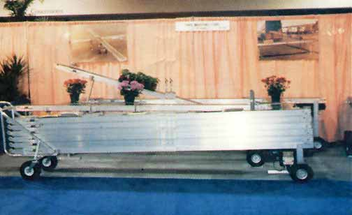 Portable conveyor folded for transit